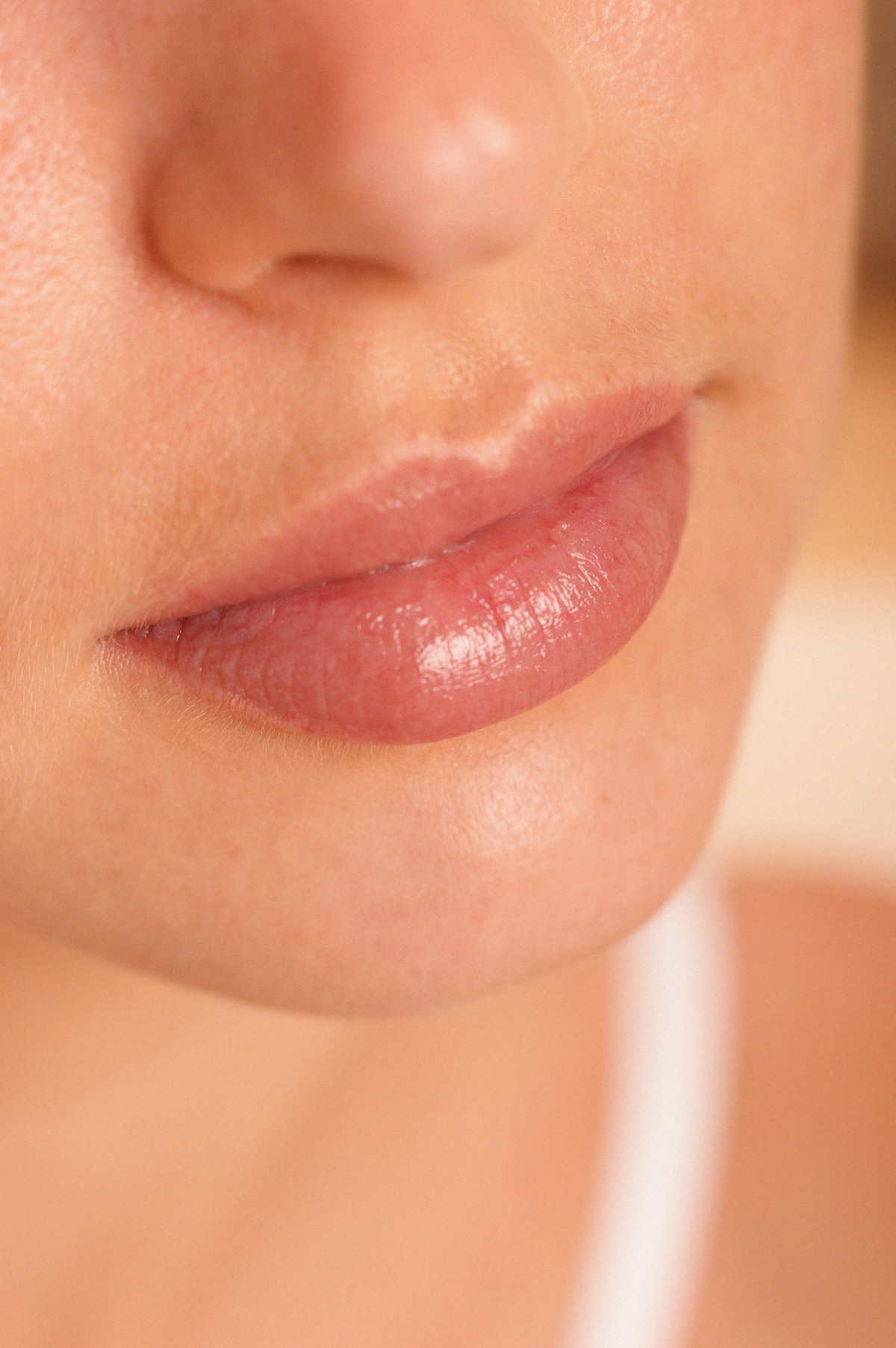 Lips of young woman --- Image by © Image Source/Corbis