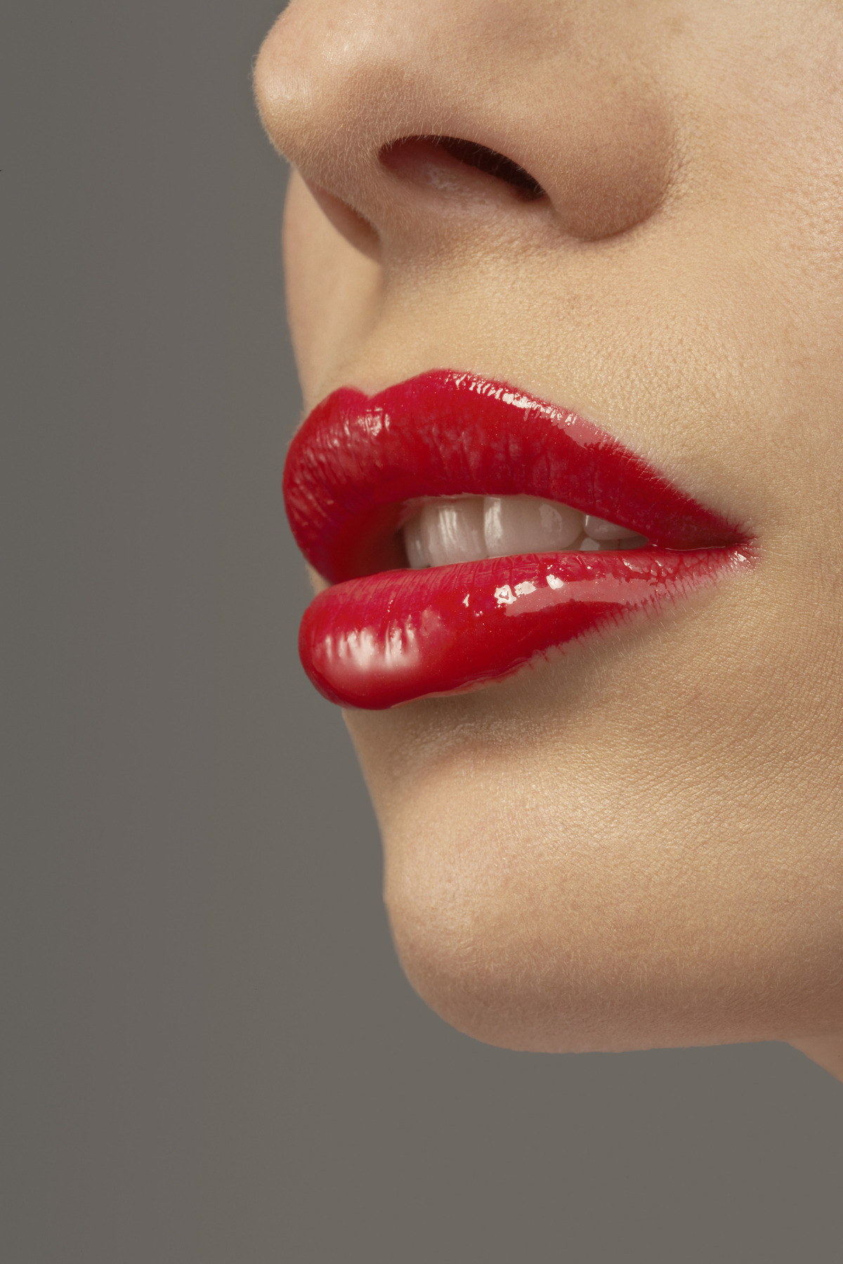 Woman Wearing Red Lipstick --- Image by © Corbis